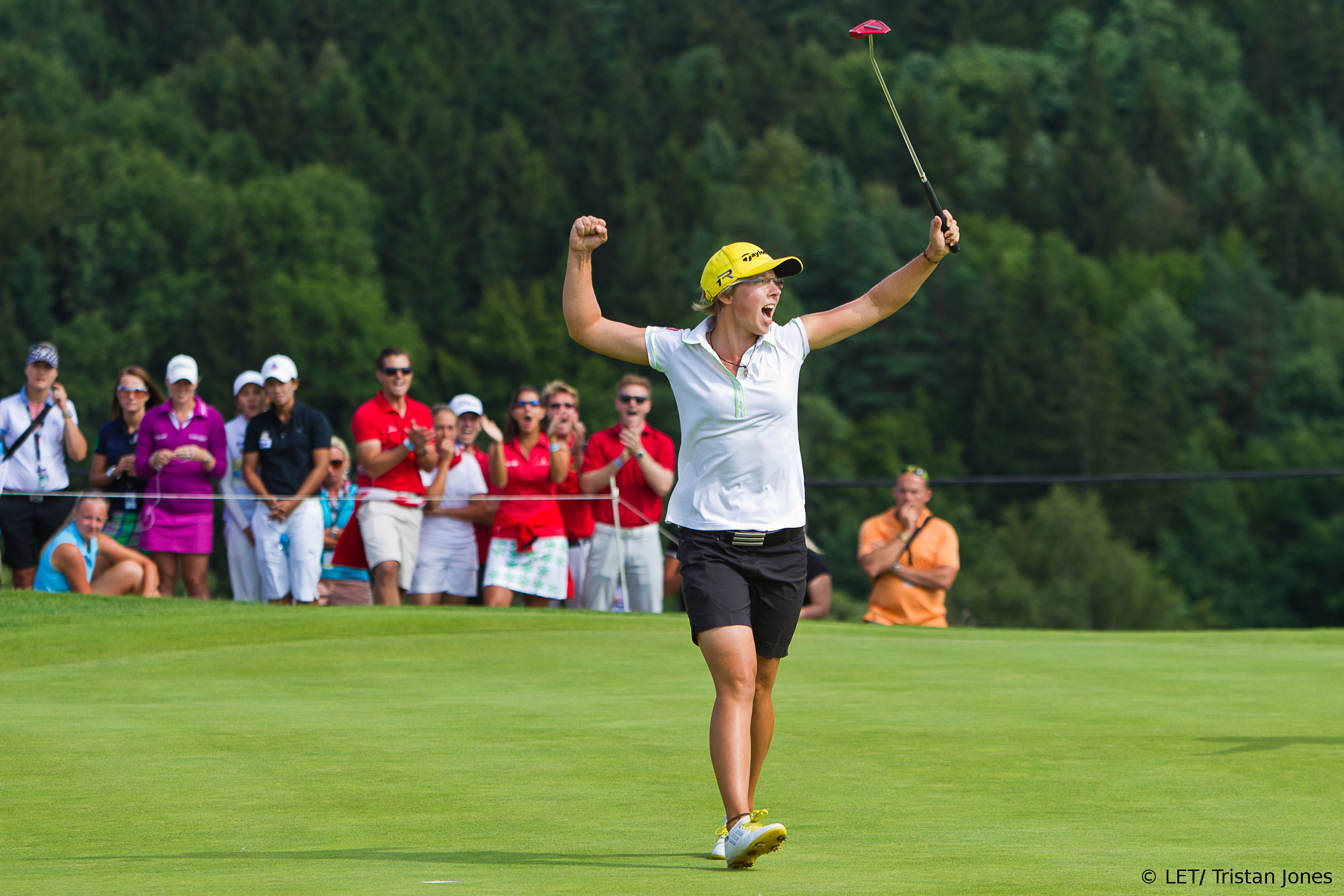Ann-Kathrin Lindner of Germany celebrates her maiden victory on the 18th hole